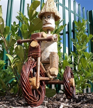 Wooden Log Man on Wicker Bike Garden Ornament